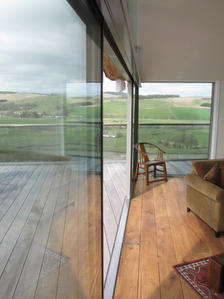 Sliding door with views onto Scottish landscape