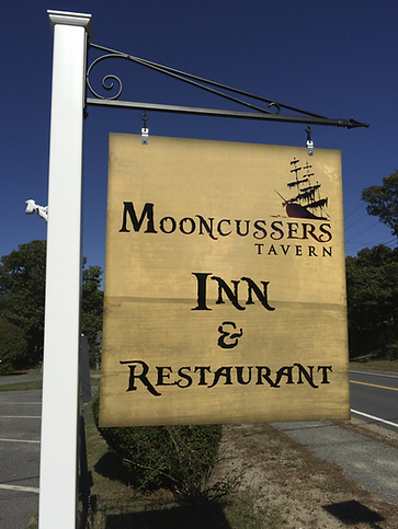 Mooncussers Tavern Inn and Restaurant hanging sign