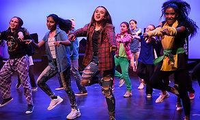 Junior production participants dancing