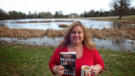 Emma Calin launching her book Shannon's Law (Passion Patrol 1) at Avington Park in Hampshire.  With a nice cuppa tea.