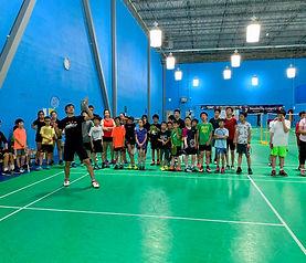badminton instructor demonstrating technique