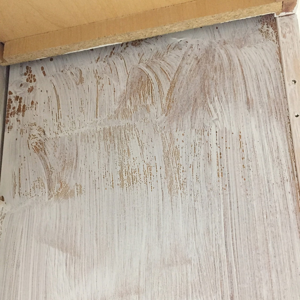 Unsanded cabinet with primer