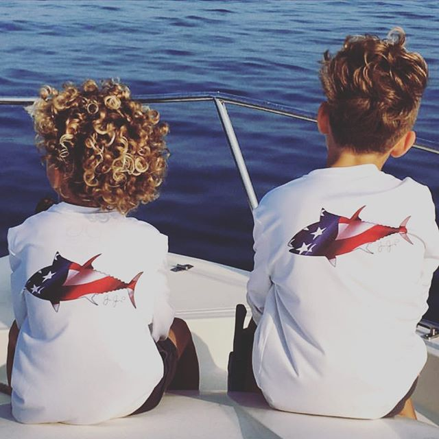These boys are most certainly twinning in our youth USA tuna performance shirts
