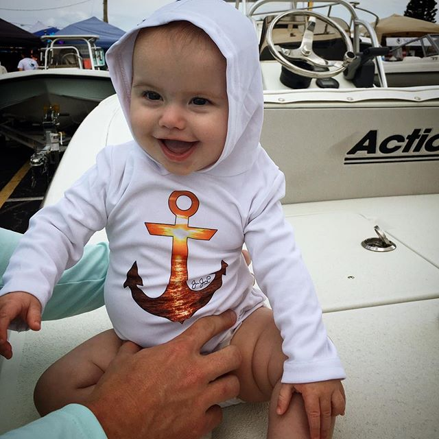 Look at this cutie pie wearing our sunset anchor baby onesie! Stop by at the Dania Beach Marine Flea