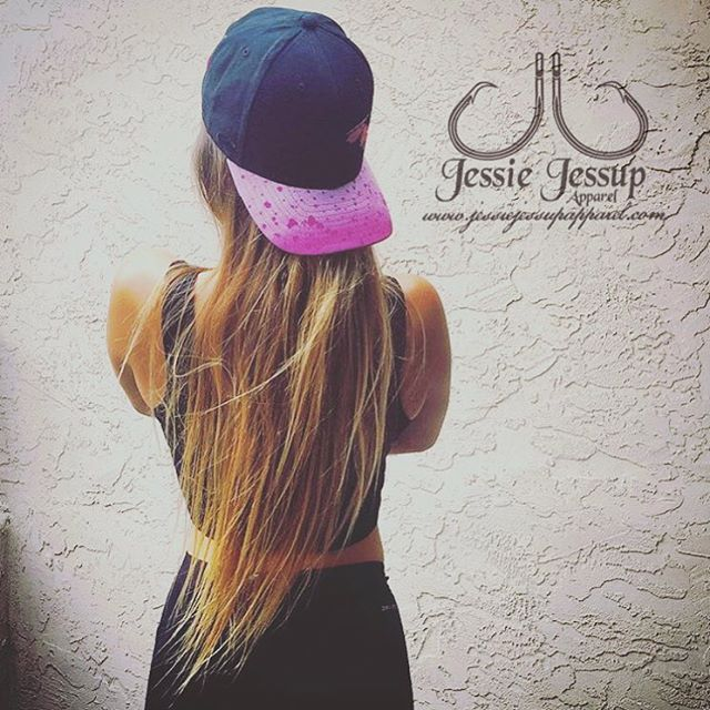 Showing off her ladies pink and black mahi print hat! Give _lionkarma a follow
