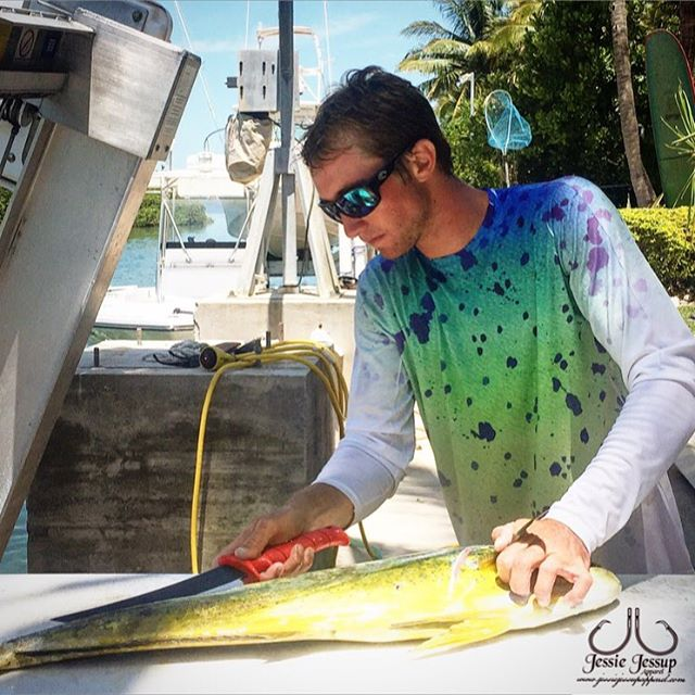 The perfect attire for catching some dolphin. Check out our shirts online. Including this one. Photo