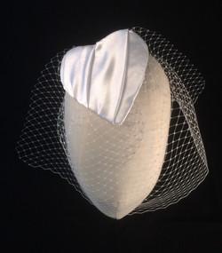 Bridal fascinator with veil