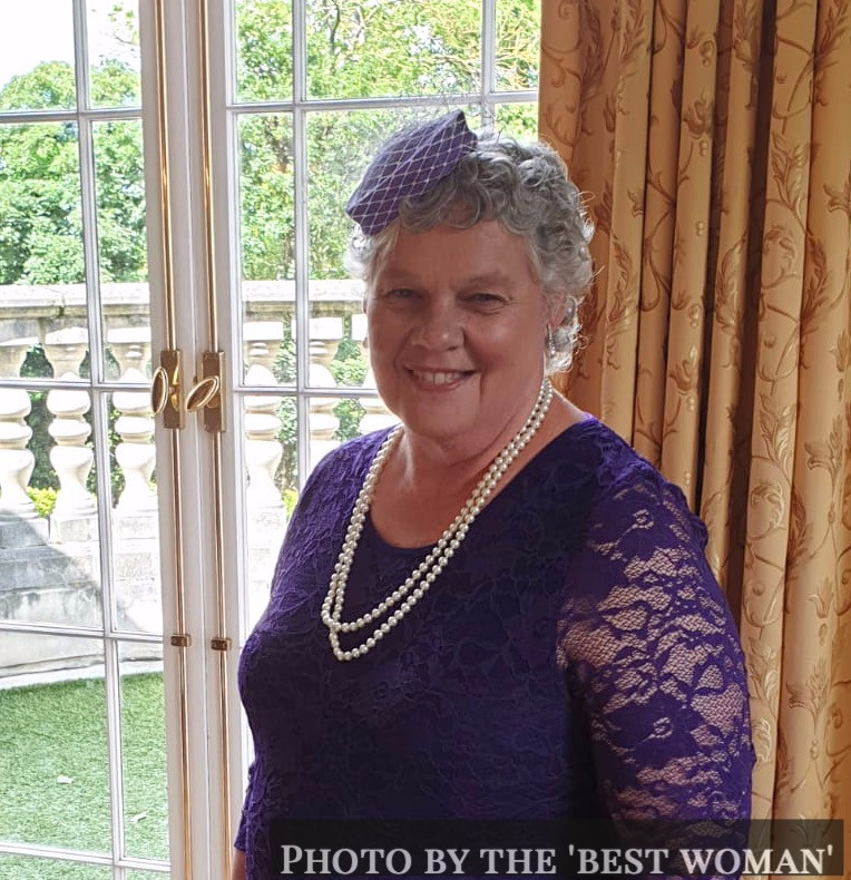 Mother of the Bride in purple, with a bespoke hat, at a wedding in Kent