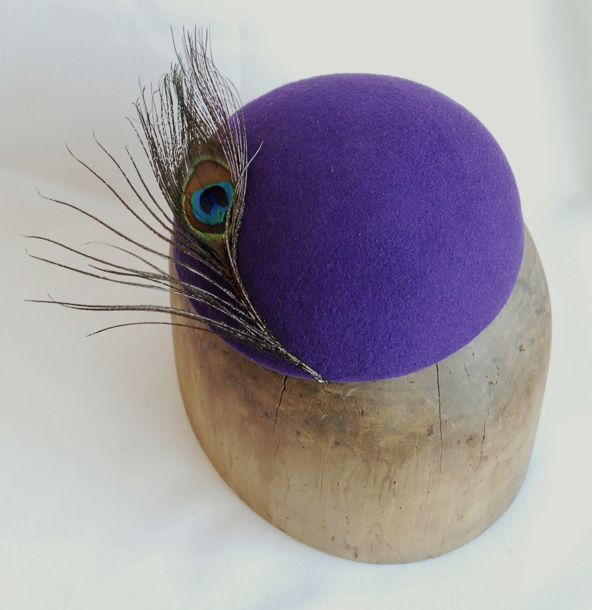Purple felt beret with peacock