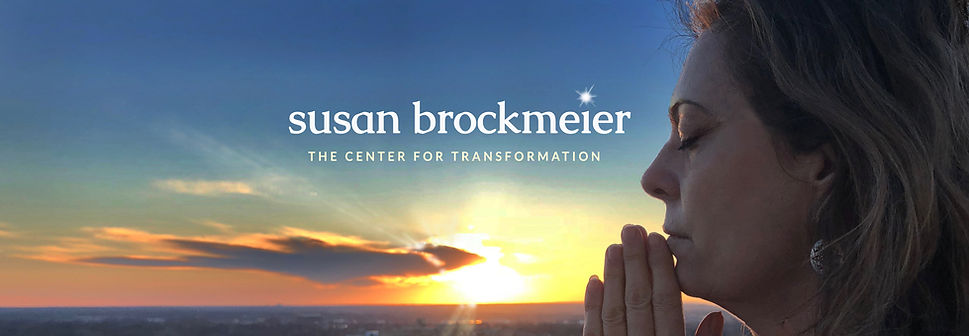 Susan Brockmeier in a Namaste pose during sunset over St. Louis /Center For Transformation