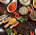 65266208-herbs-and-spices-on-dark-wooden