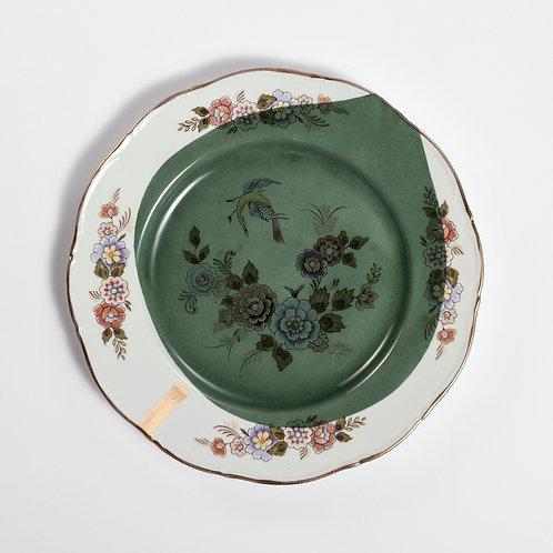 Assiette plate en porcelaine ancienne avec motifs floraux