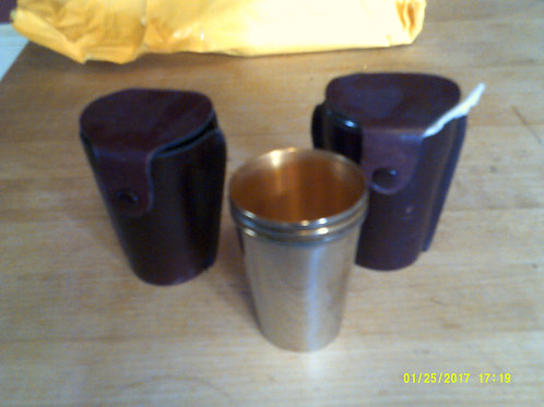 Silver stirrup cups in leather case