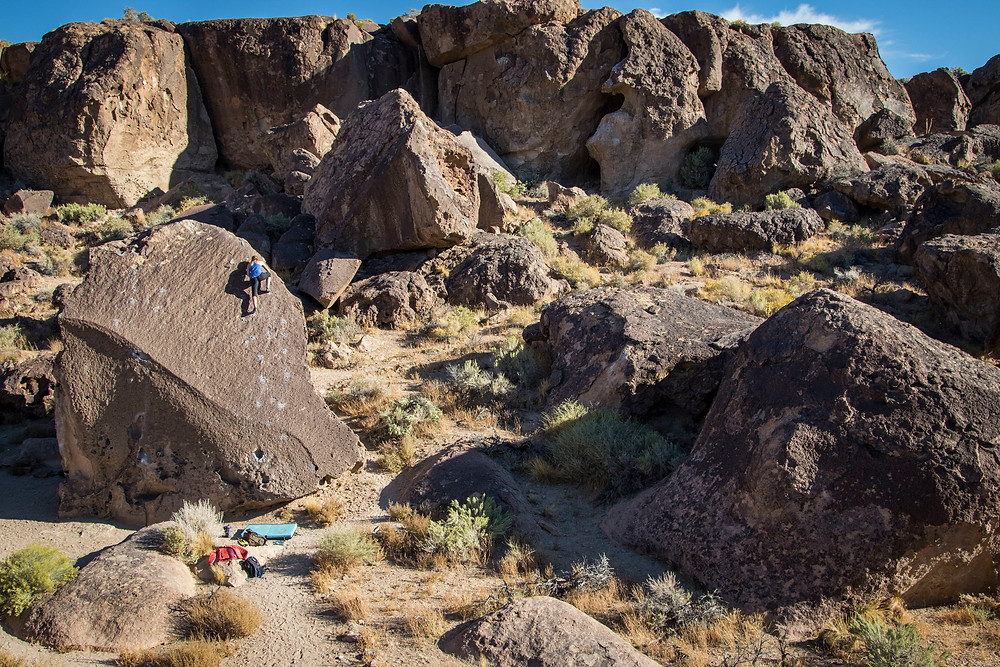 climbing the buttermilks boulders in bishop california