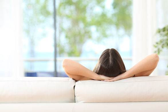 Woman relaxing with hands behind head.jpg