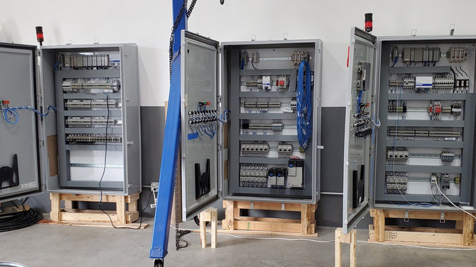 Performing a Factory Acceptance Test on these high quality custom UL508A engineering enclosures!