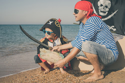 Dad And Son Search for Pirate Goodies Treasure