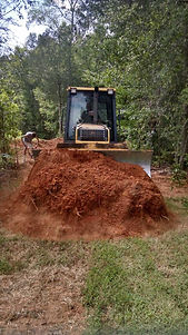 Bulldozer moving dirt for a construction site