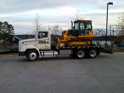 McCrone Excavating LLC Truck and Dozer ready to work at a commercial construction project in the Carolinas
