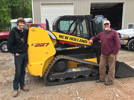 Mr. Ronald McCrone with his son. Mr. McCrone is the owner and operator of McCrone Excavating LLC