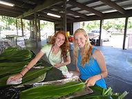 Teen Mentors making Hawaiian hula skirts with tei leaves