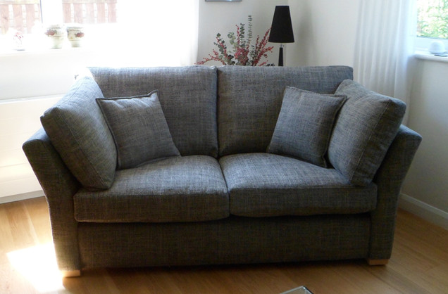 Two seater sofa recovered in linen fabric