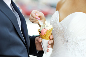 bride with an ice-cream which is in the hand of the groom