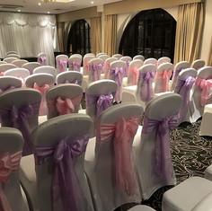 Chair covers and bows #weddingchairdecor #weddingchaircovers #ceremony #weddingbells