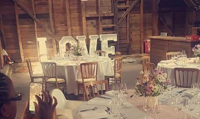 Barn wedding hanging lanterns and love l