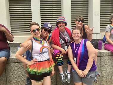 Group of Deaf women smiling at Pride event