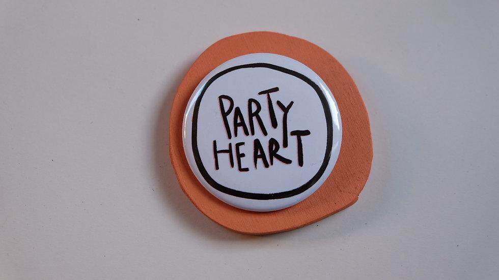 Button: party ❤️