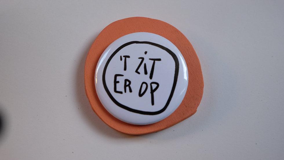 Button: 't zit erop