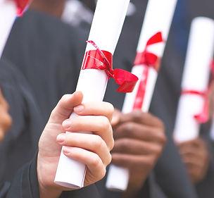 Graduates%20Holding%20Diplomas_edited.jp