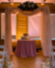 Wash Bars lighting a ceremony arch for a wedding