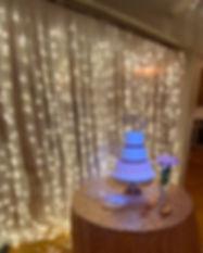 Warm white LED backdrop behind a wedding cake