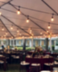 Market lighting for a wedding in a tent