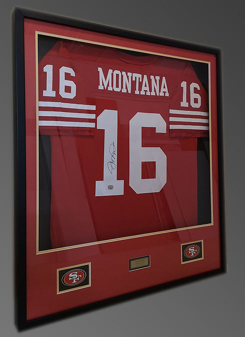 Framed and matted football jersey