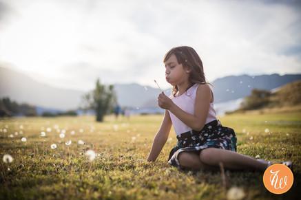 Little girl blowing on a dandelion again