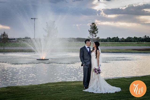 Bride and groom next to pond
