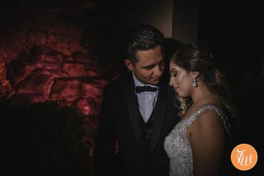 Bride and groom posing at night