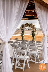 Ceremony chait and floral arch
