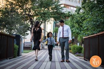 Family walking thourgh bridge