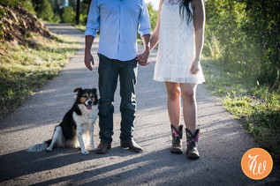 Engaged couple and their dog