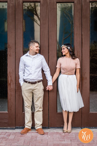 Couple holding hands in front of doors