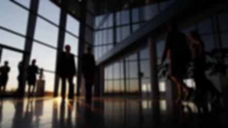 business-people-walking-through-modern-f
