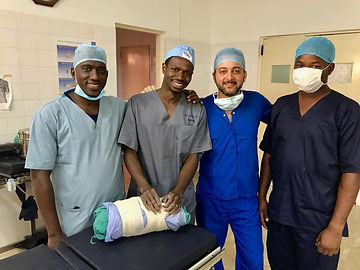 Dr Sherief Elsayed helping the only Neurosurgeon in the Gambia