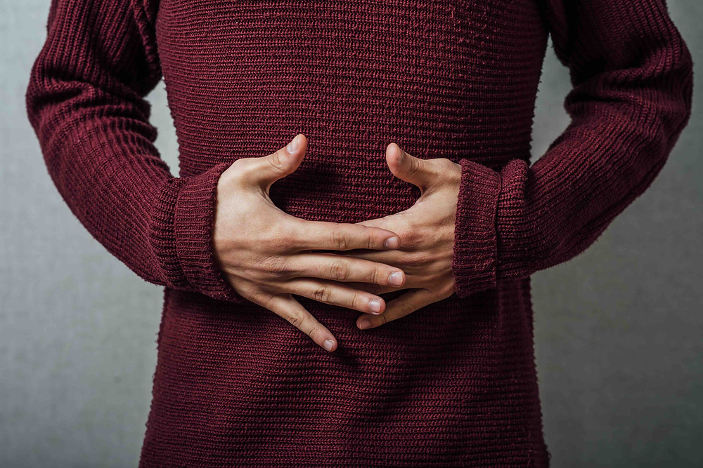 Man with hands on stomach diaphragmatic breathing