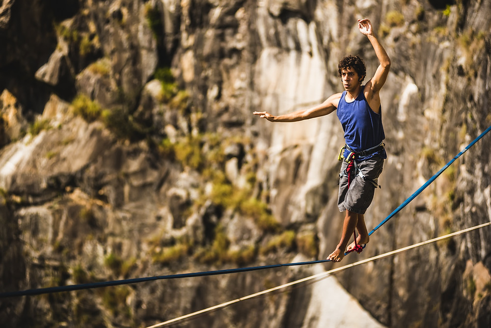 a tight rope walker up high in the mountains