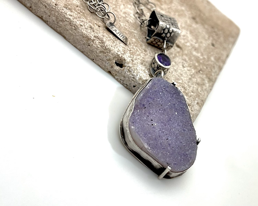 large lavender colored drusy pendant bezel set with sterling silver. comes with handmade sterling silver chain.