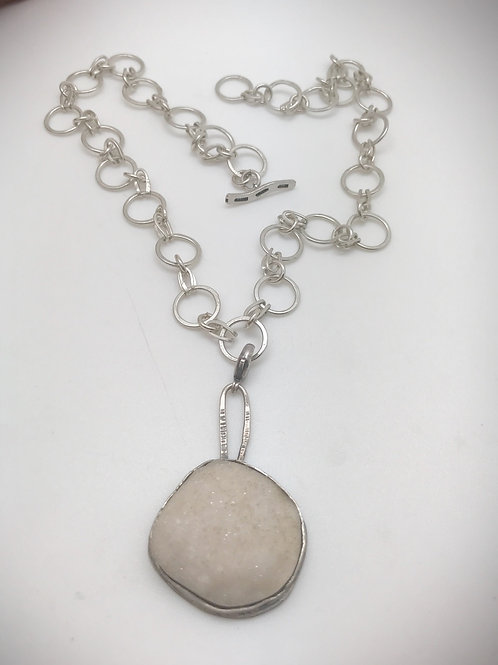 Cream colored natural drusy pendant bezel set in sterling silver with completely